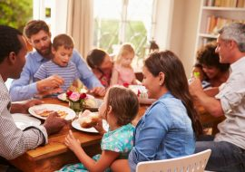 Family and friends enjoying a meal can also be a source of holiday anxiety.