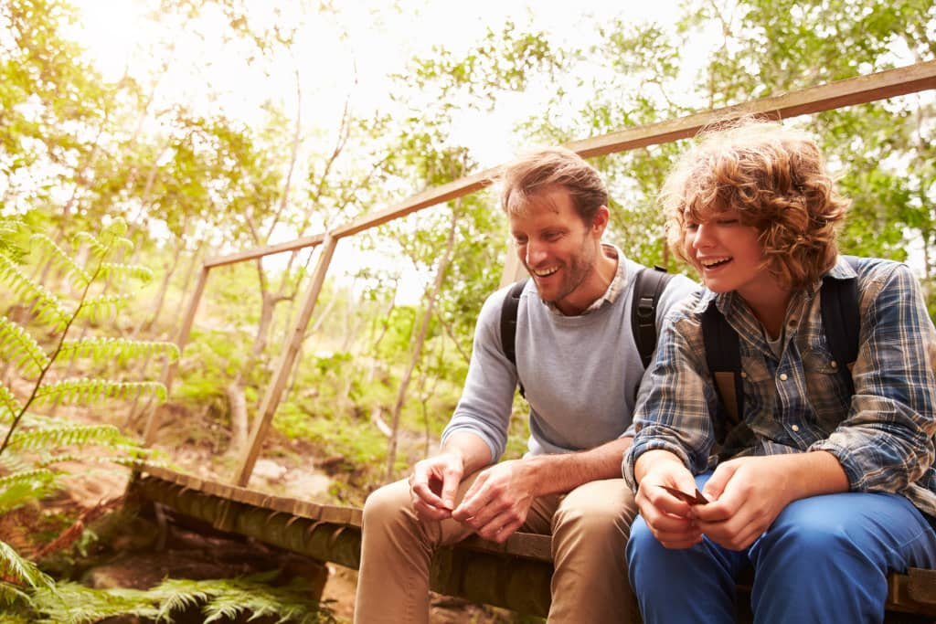 Father and son on a hike can be a way to connect when parenting an ADHD adolescent.